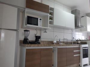A kitchen or kitchenette at Apartamento Criciúma