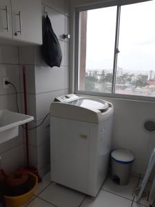 A bathroom at Apartamento Criciúma