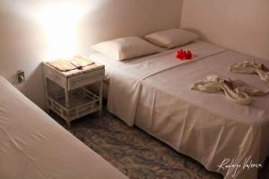 Cama ou camas em um quarto em Pousada Dois Irmãos