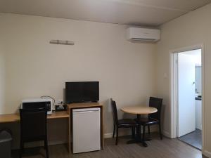A television and/or entertainment center at Dandenong Motel