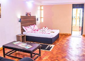 A bed or beds in a room at Anka Resort