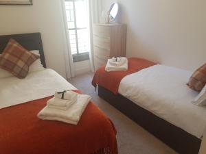A bed or beds in a room at Chic Living in the Heart of the City