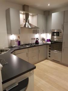 A kitchen or kitchenette at Chic Living in the Heart of the City