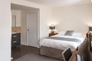 A bed or beds in a room at The Birchtree Hotel
