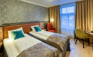 En eller flere senger på et rom på Clarion Collection Hotel Hammer