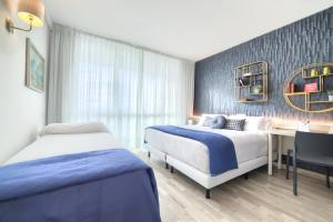 Cama o camas de una habitación en El Villa Castejon