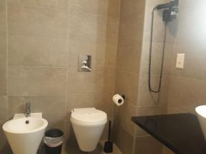 Un baño de Flag Hotel Miravillas
