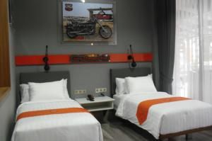 A bed or beds in a room at Sturgis Boutique Hotel Cipanas