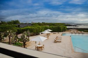 A view of the pool at Finch Bay Galapagos Hotel or nearby