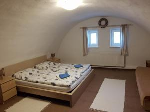 A bed or beds in a room at Privat DANO