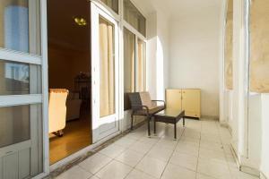 Uma área de estar em Stay Inn Seaside Apartment