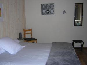 Un ou plusieurs lits dans un hébergement de l'établissement Lo Saunei