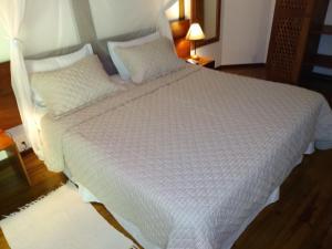 Cama ou camas em um quarto em Anima Hotel
