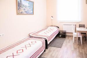 Кровать или кровати в номере Апартаменты Иерусалимская