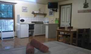 A kitchen or kitchenette at Fernleigh Accommodation