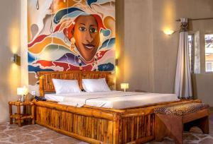 A bed or beds in a room at Bamboo Village Resort