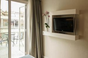 A television and/or entertainment centre at Athens Cypria Hotel