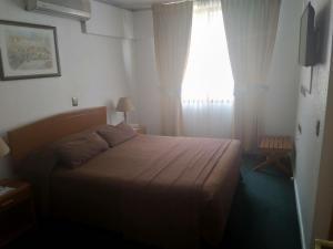 Cama ou camas em um quarto em Hotel Maria Angola