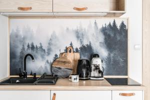 A kitchen or kitchenette at Tamok Lifestyle Villa