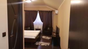 Кровать или кровати в номере Vila Crinul