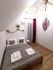 Łóżko lub łóżka w pokoju w obiekcie Goorskie - domki w Szczyrku
