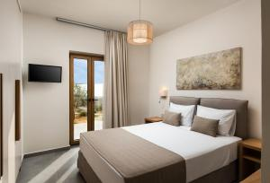 A bed or beds in a room at Amaré Chania Luxury Residence