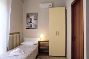 Cama ou camas em um quarto em Cameracaffè Centro