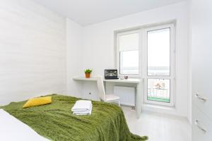 A bed or beds in a room at Apartments Roomer 33