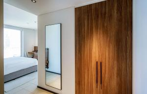 A bed or beds in a room at FORM Hotel Dubai, a member of Design Hotels™