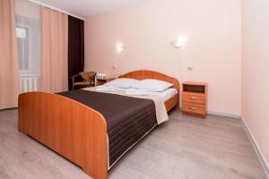 Кровать или кровати в номере Гостиница Сортавала