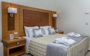 Ένα ή περισσότερα κρεβάτια σε δωμάτιο στο Apollo Blue