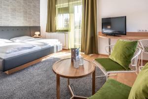 Ein Bett oder Betten in einem Zimmer der Unterkunft Hotel Birkenhof