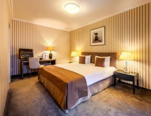 Un ou plusieurs lits dans un hébergement de l'établissement Ambra Hotel