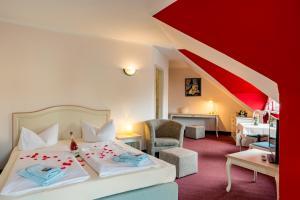 Ein Bett oder Betten in einem Zimmer der Unterkunft Hotel Overdiek