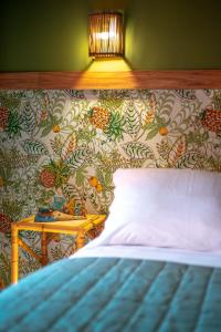 A bed or beds in a room at Pousada Villa Maeva Itacimirim