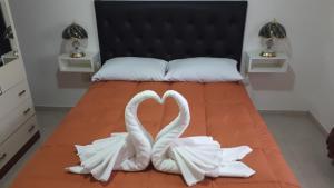 A bed or beds in a room at EL PATAGON viviendas