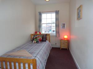 A bed or beds in a room at Hull Trinity Backpackers