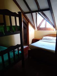 A bed or beds in a room at Hotel Campestre los Duraznos