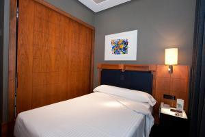 Cama o camas de una habitación en Gran Hotel Lakua