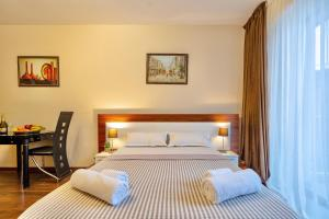 A bed or beds in a room at GVC New Gudauri