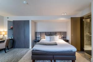 A bed or beds in a room at Terhills Hotel