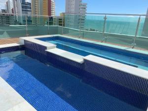 The swimming pool at or near Premium Flat Ponta Negra Vista Mar