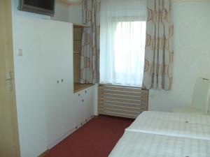 Ein Bett oder Betten in einem Zimmer der Unterkunft Frühstückspension Leopold Janu