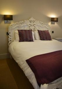 A bed or beds in a room at The Bell