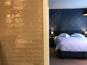 Een bed of bedden in een kamer bij Neutralia
