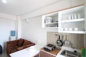 A kitchen or kitchenette at Apartemen Bassura City by Aparian