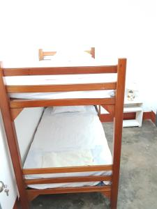 A bunk bed or bunk beds in a room at Urcututo House