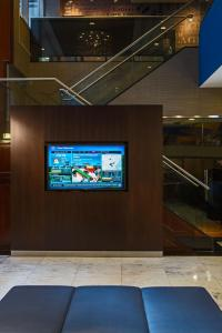 A television and/or entertainment center at Courtyard by Marriott New York Manhattan/ Fifth Avenue