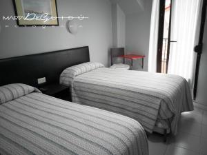 A bed or beds in a room at Pensión La Mar