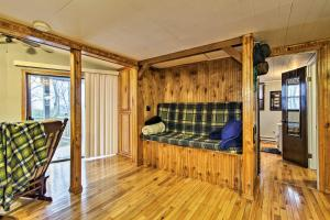 A seating area at Rustic Stockton Lake Cabin Half Mile to Boat Ramp!
